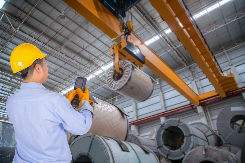 In which industries are material handling systems essential?